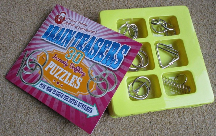 Professor Murphy Metal Puzzle Set book and shapes
