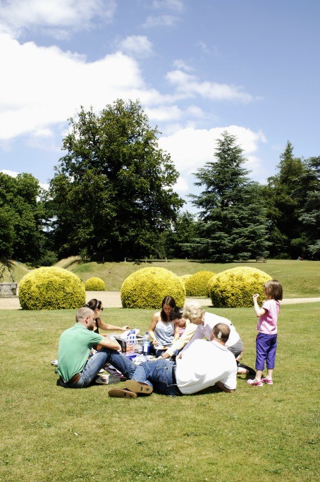 A family enjoys a picnic on the lawn at Polesden Lacey, Surrey ©National Trust Images Stuart Cox