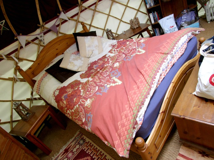 double bed in the yurt